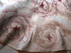 Silk taffeta, embroidered all over.